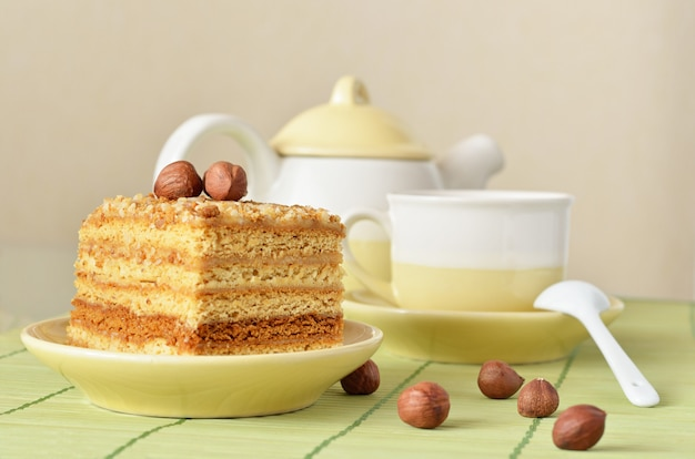 Honey cake with nuts and a cup of coffee