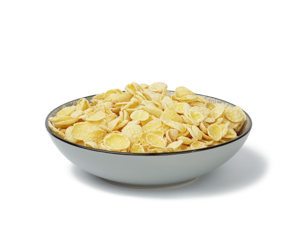 Honey cornflakes on a white background. morning breakfast with milk
