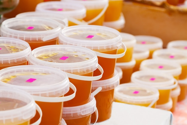 Honey on counter in market