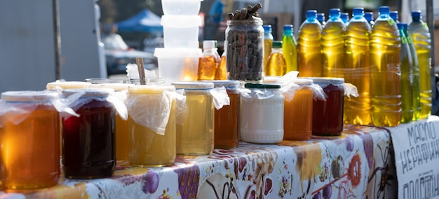 Honey on the counter for sale.
