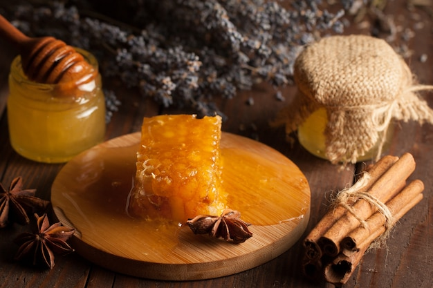 Honey dipper and honeycomb. nuts and apples with honey and nuts of various kinds