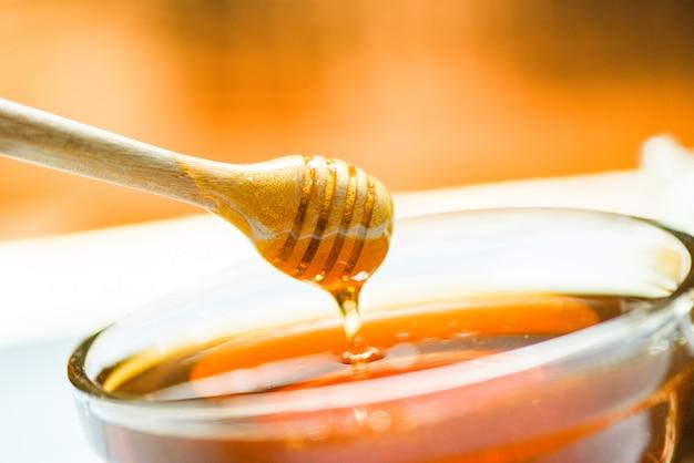 Honey dripping on honey jar