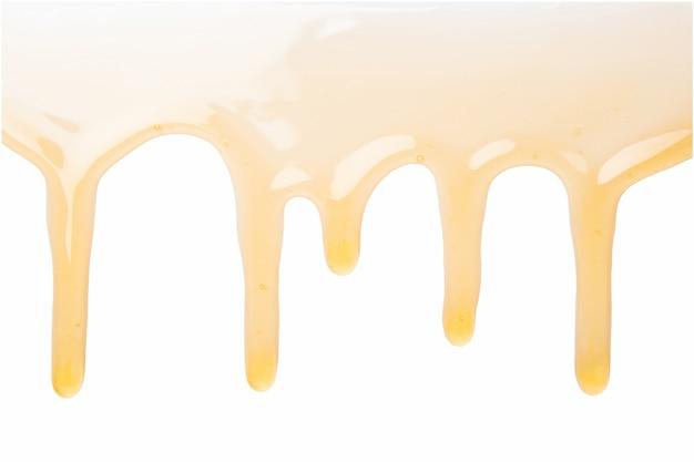 Honey drops on white background
