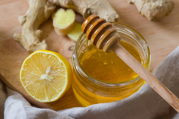 Honey in a glass jar, lemon, ginger. folk remedies for the treatment of colds. organic flu remedies