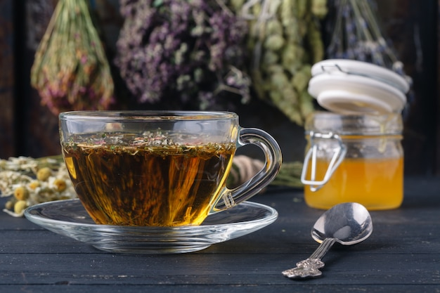 Honey and healing herbs for folk medicine, ethnoscience concept