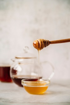 Honey and honey stick with blurred background