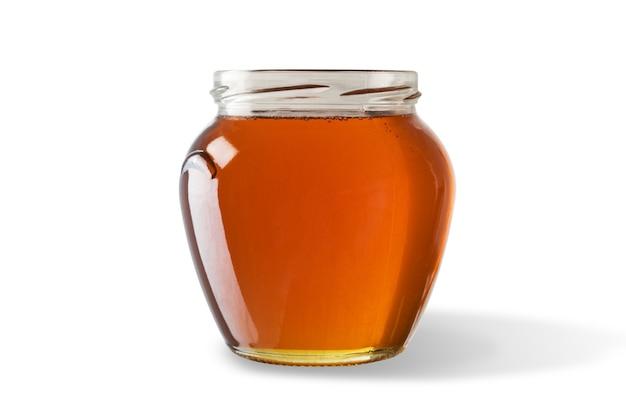 Мед в банке, изолированные на белой поверхности.