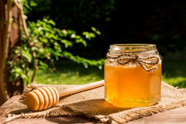 Honey jar outdoors