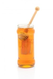 Honey jar on white