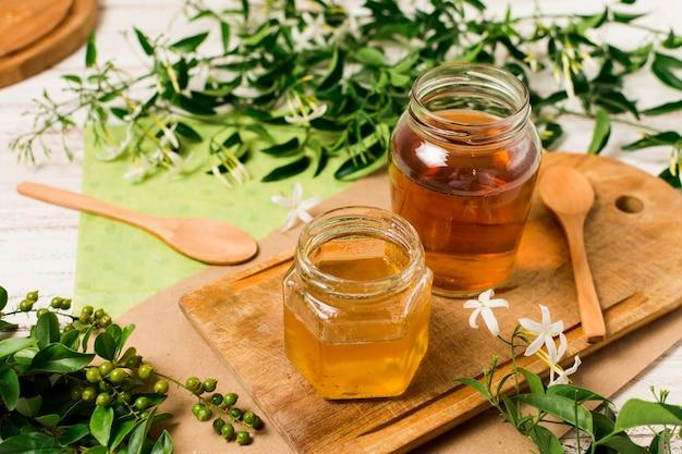 Honey jars with plants
