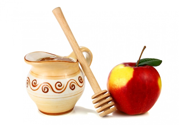 Honey in a jug and apple
