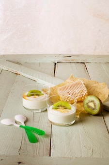 Honey and kiwi yogurt with copy space