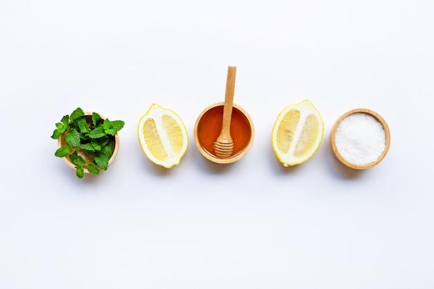 Honey , lemon, mint and salt on white background.