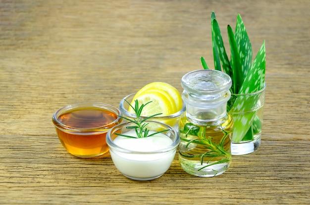 Honey, lemon, rosemary leaves, yogurt, aloe vera and essential oil for homeopathy remedy