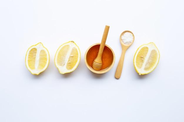 Honey, lemon and  salt on white