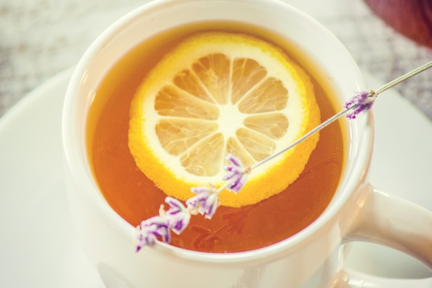 Honey and lemon tea for breakfast. selective focus.