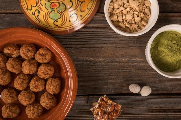 Honey nut bar with meatballs on table