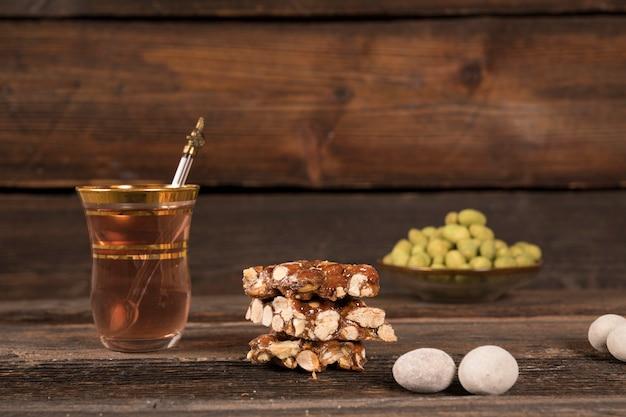 Honey nut bar with tea on table