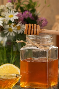 Honey in a pot or jar on a wooden table