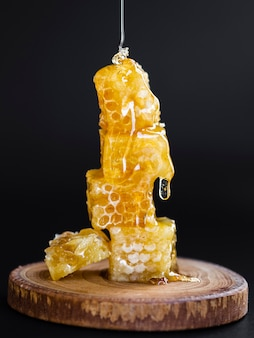 Honey pouring on honeycombs