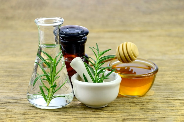 Honey, rosemary and essential oil for homeopathy remedy.