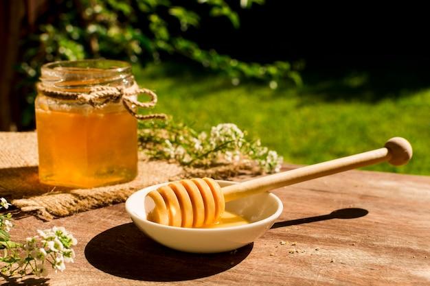 Honey spoon on bowl