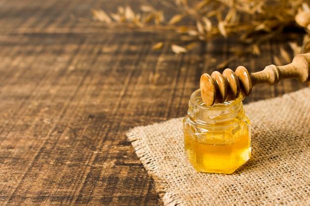 Honey spoon on jar