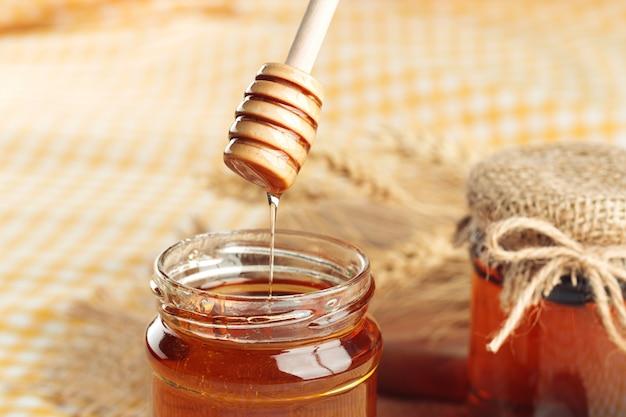 Honey. sweet honey in glass jar on wooden.