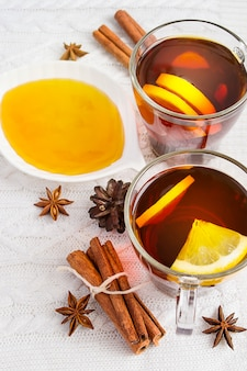 Honey,  tea with lemon and cinnamon sticks