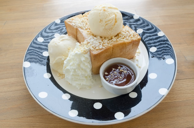 Honey toast, consists of bread topped with honey and ice cream