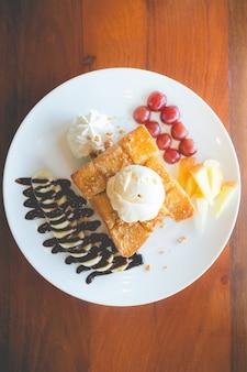 Honey toast with vanilla ice cream, whipped cream and chocolate syrup.