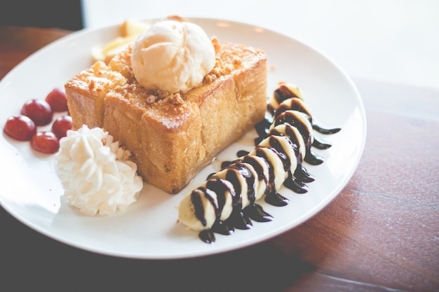 Honey toast with vanilla ice cream, whipped cream and chocolate syrup.