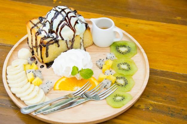 Honey toast with whipped cream, ice cream and fruit