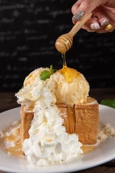 Honey toast with whipped cream and vanilla ice cream