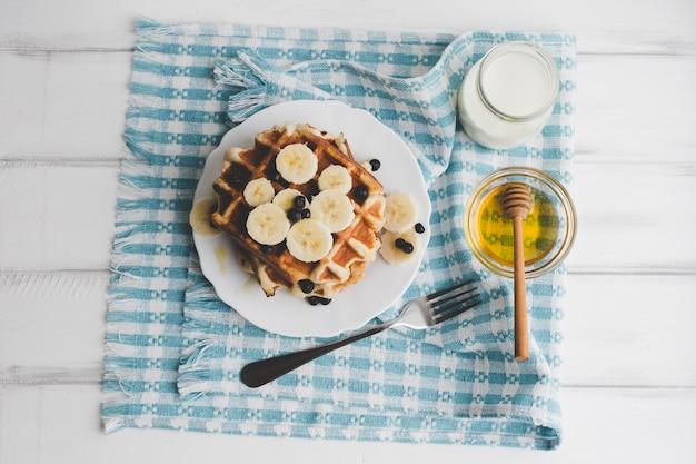 Honey and waffle on towel