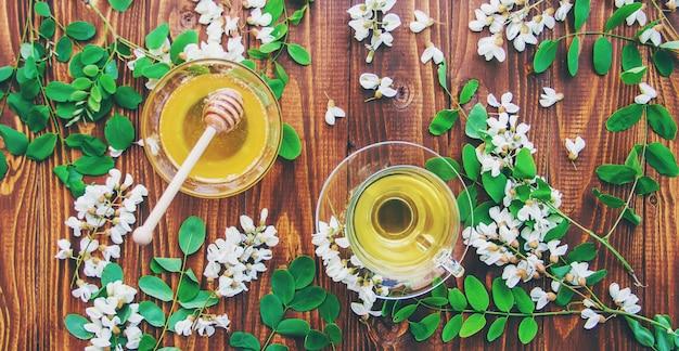 Honey with acacia and tea. selective focus.
