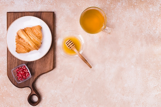 Honey with croissant copy space