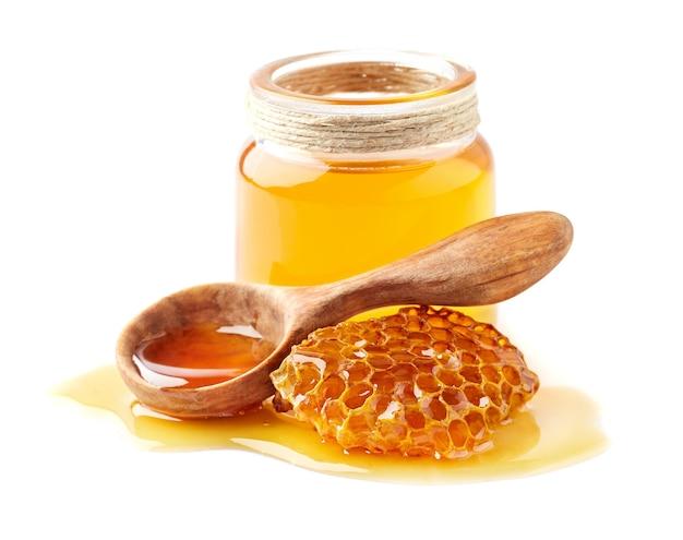 벌집과 나무로되는 숟가락과 꿀