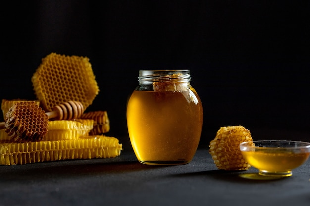 Honey with honeycomb on table