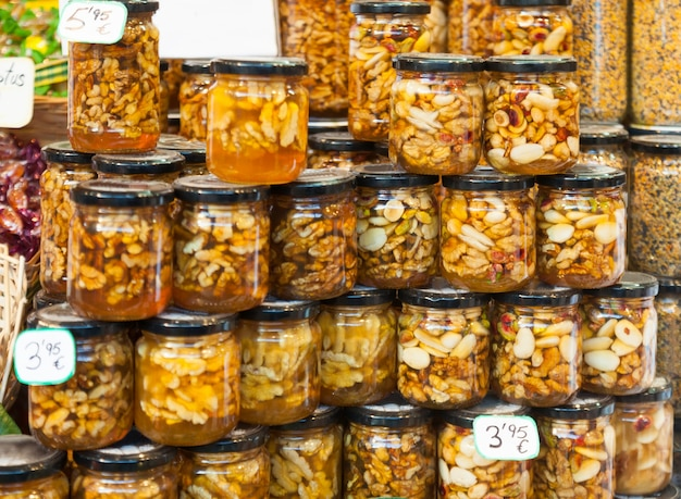 Honey with nuts in glass cans