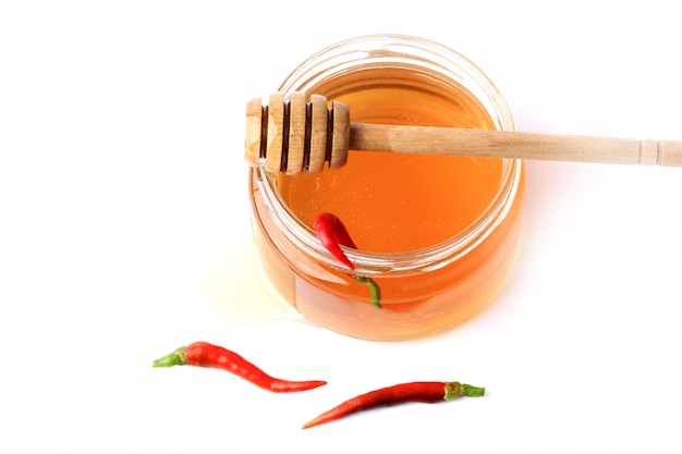 Honey with red hot pepper isolated