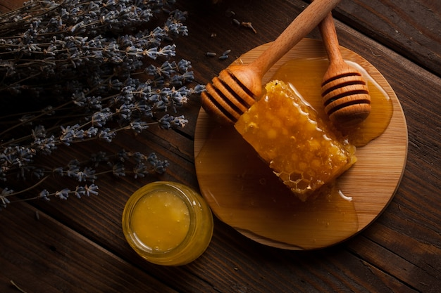 Honey on wooden background.