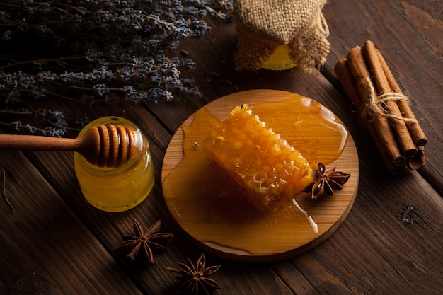 Honey on wooden background.