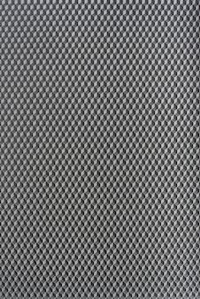 벌집 추상 그림. 회색 기하학적 추상 배경입니다. 수직 프레임.