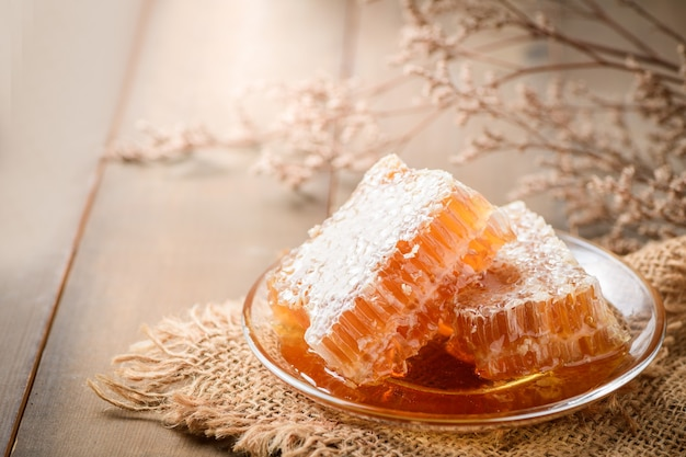 Honeycomb on dish, bee products by organic natural ingredients concept