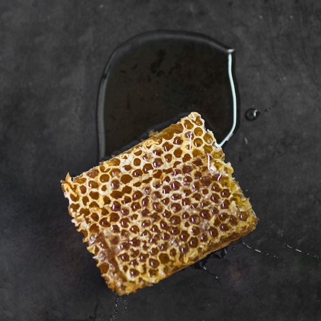 Honeycomb piece on black textured background