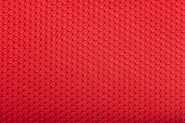 ハニカムテクスチャ。赤い幾何学的な抽象的な背景。