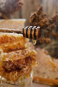 Honeycomb with honey spoon