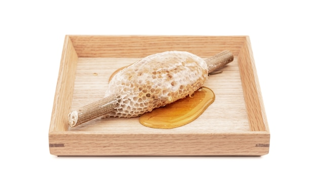 Honeycomb on wooden plate for food ingredients isolated