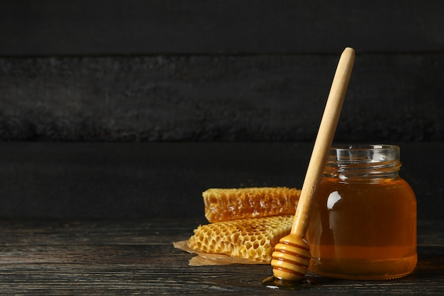 Honeycombs, jar with honey and dipper